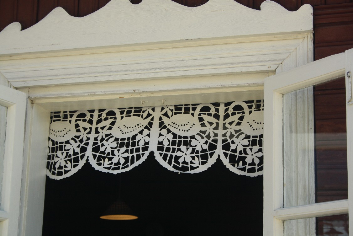 Fake lace drapes made from paper - Lithuania has always been poor, but never on the expense of elegancy.