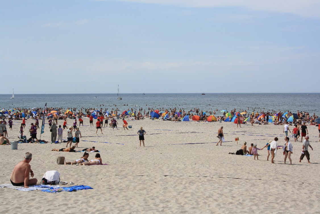 The beach of Warnemünde is wide and very close to the town center and in summer full of young people.