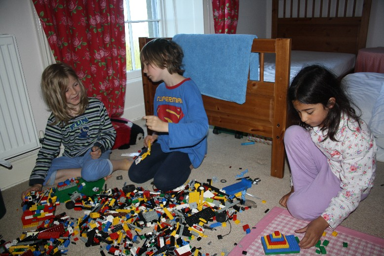 It doesn't take much to make friends out of stranger's children. 4,385 lego bricks do well.