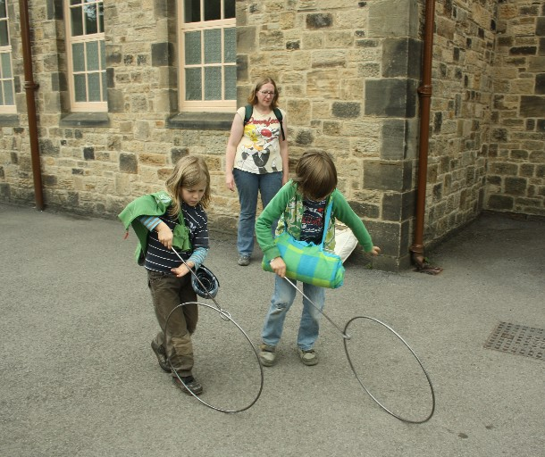 Our couchsurfing host Kathryn taught our boys how to deal with the simple toys at the village school of Pit Village.