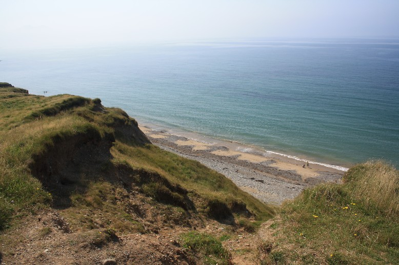 In the middle of the ironage hillfort that has partly being claimed by the sea.